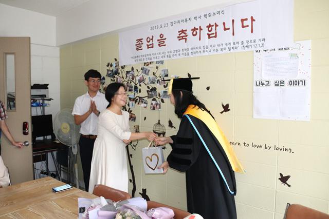 2019 08 23 Kim Maria Ph D Graduation  11.jpg